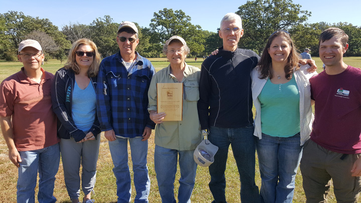 DNR's Jared Urban and Sharon Fandel, far right, presented the Volunteer Steward of the Year Award to members of the Chiwaukee Prairie Preservation Fund including, left to right: Chad Heinzelman, Amy Duhling, Alan Eppers, Pam Holy and Nathan Robertson.