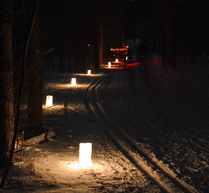 Hundreds of luminaries are placed out along trails for candlelight events.  These are in ice buckets at the Southern Unit of the Kettle Moraine. - Photo Credit: DNR by Ed Culhane